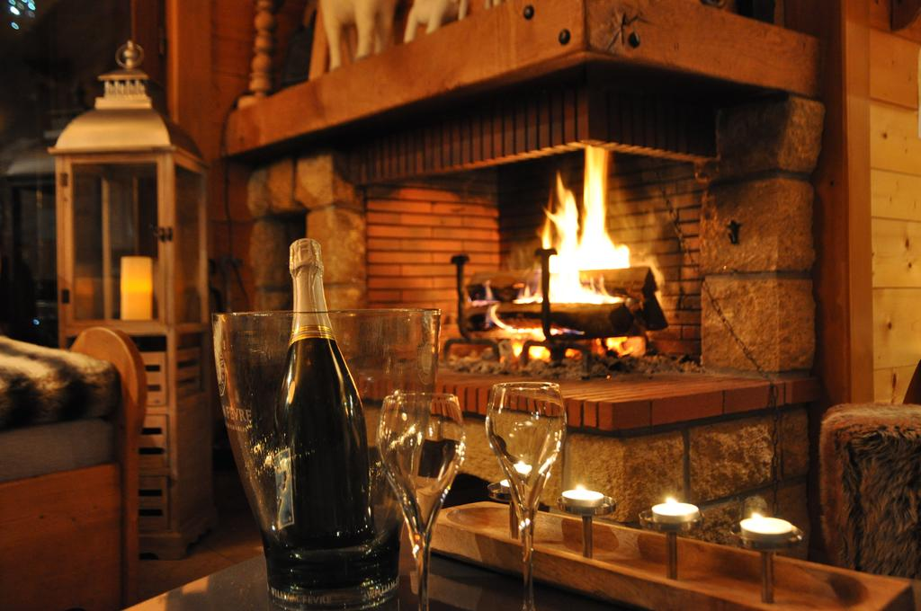bottle of champagne at the corner of the fireplace